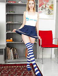 Check out this amazing little blonde babe as she poses naked wearing her cute and sexy striped socks.