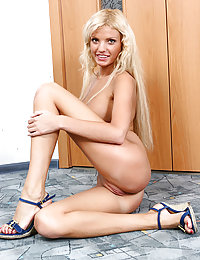 Come close and watch a sweet Russian teen babe's hot striptease show in front of the camera.